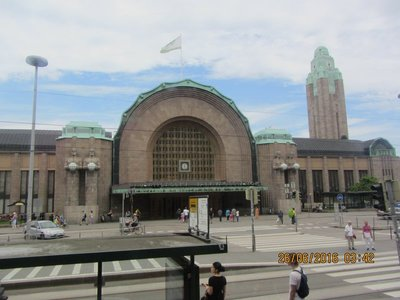 Helsinki Central Railway Station with statues holding lamps