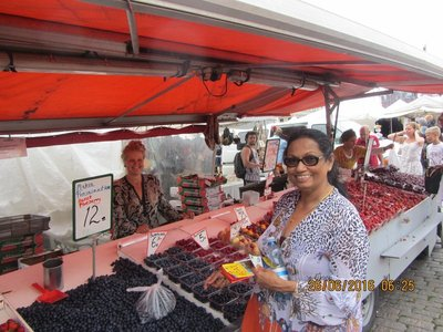 Mala buying berries from a Market Square Stall