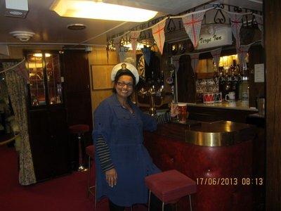 Mala posing as having a beer on Britannia