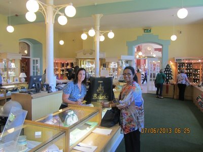 Mala with the sales person buying limited edition Belleek item