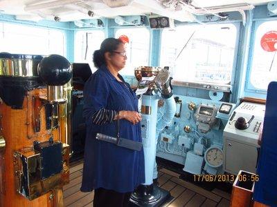 Mala in the captains control room of Royal ship, Britannia