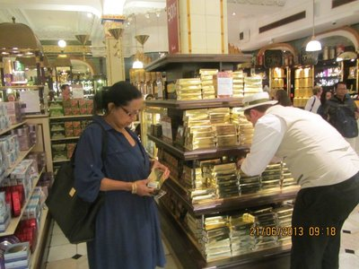 Mala selecting chocolates in Harrods