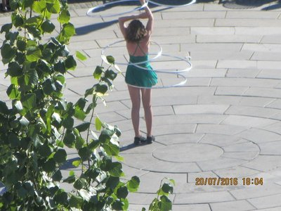 Street performer - Girl playing with her hooplas