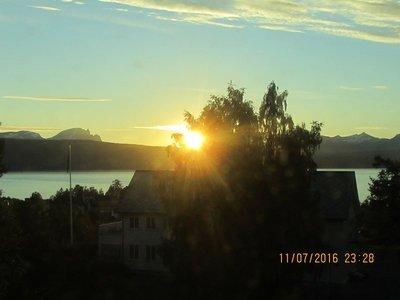 Sun still above the mountain range at 11:30PM