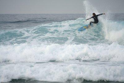Sufer takes a wave in Razo (Galicia)