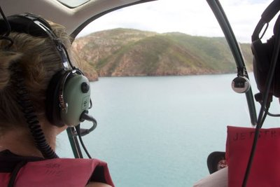 Sue flying the chopper over the falls