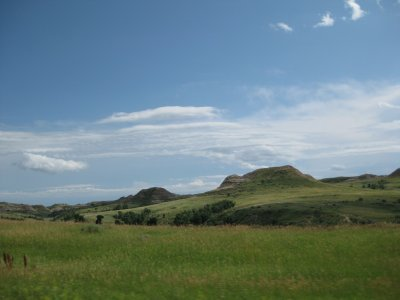 Sprawling green countryside with Badland bumps