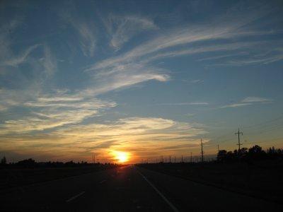Driving into Manitoba Prairie Sunset