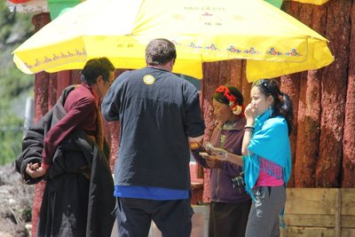 Jeremy and Nicole buying Yak Cheese and Yogurt from Tibetans
