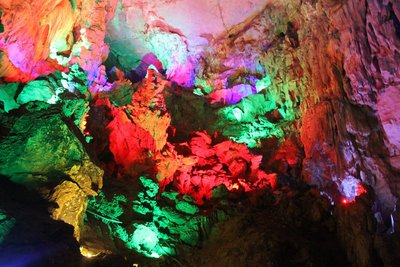 Lights inside the Guanyan Caves reflecting off of the surfaces
