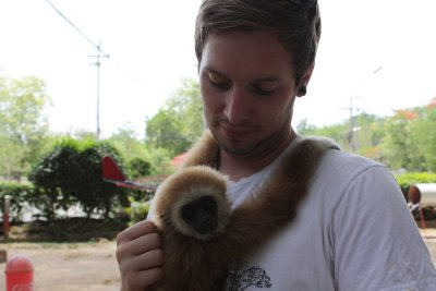 Liam and baby gibbon at zoo near Lat Ya