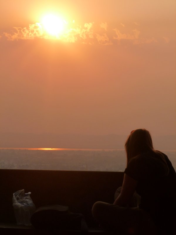 Chelsaa watching the sunset over Mandalay from Mandalay Hill