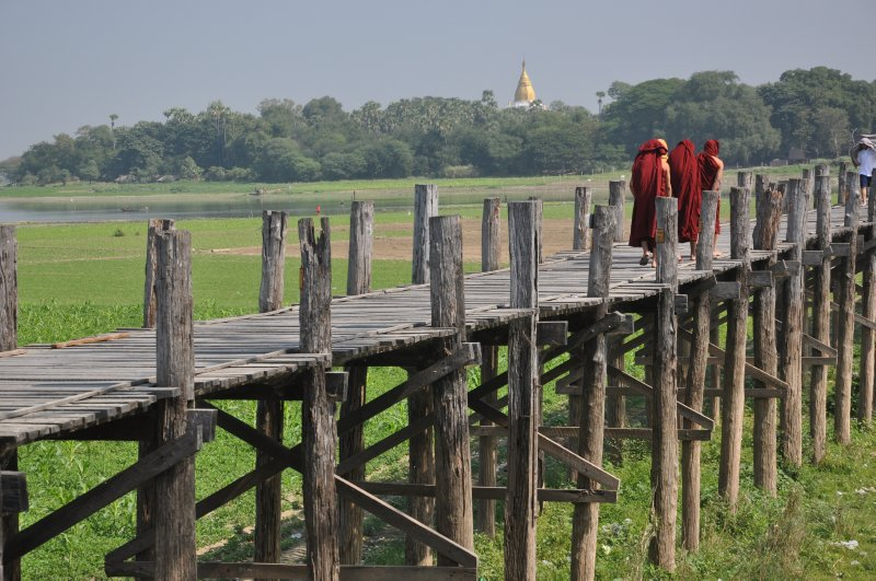 Monks crossing the teak bridge