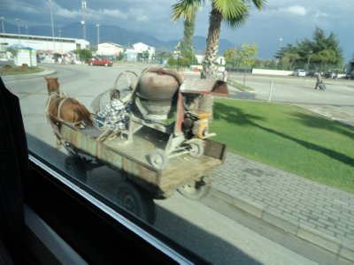 Horsecart pulling cement mixer by the Tirana airport