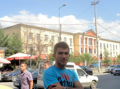Xherri in front of his University