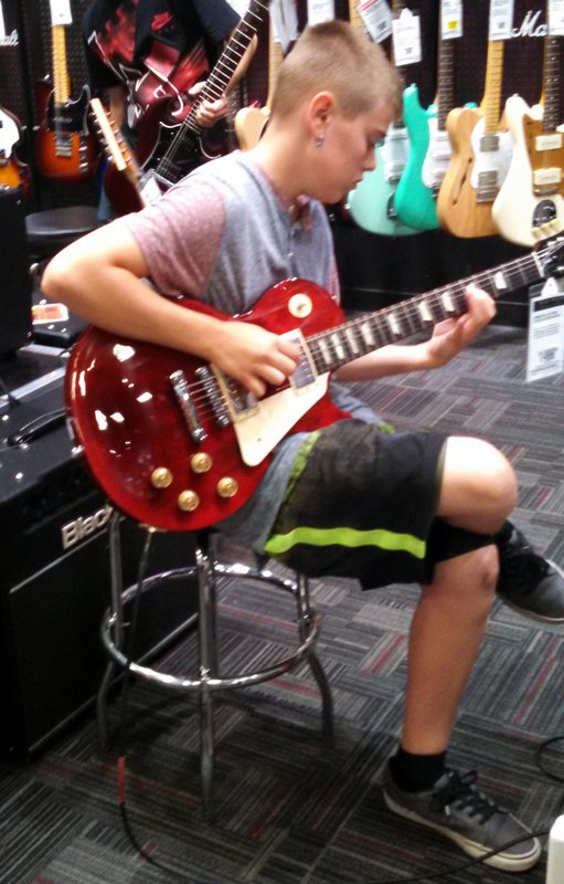 Playing a Les Paul Bass