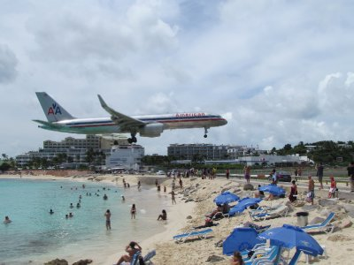 American Airlines Plane skimming the heads of tourists at Maho Beach, Saint Martin