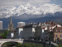 View of Grenoble from the Isère River with the Alps in the Background