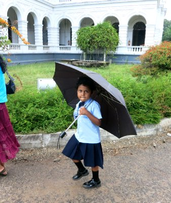 Girl with umbrella at Colombo Museum
