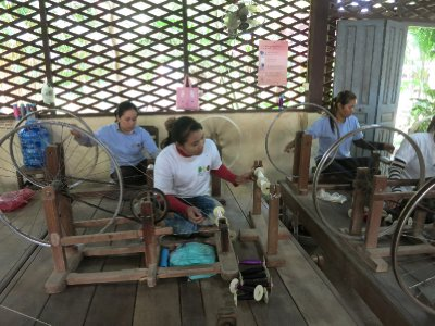 Girls spinning silk thread