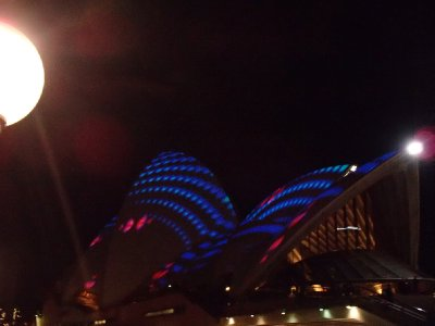 The opera house (lit up with part of the light show)