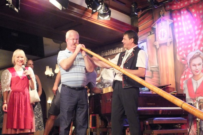 me blowing an alpine horn