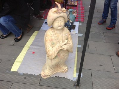 A white statue of a plump Tang lady at the open market at Tang West Market.
