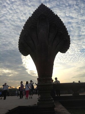 At the mote entrance of Angkor Wat , tourists were still hoping to see the sunrise.