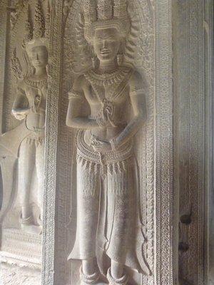 Beautifully carved Apsara dancer at Angkor Wat wall.