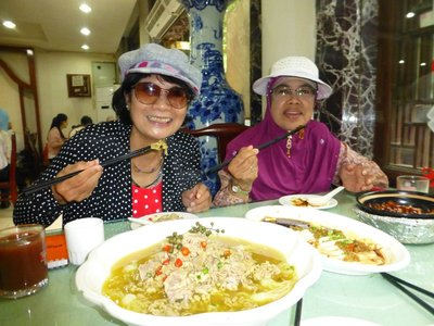 Ellie and I are having our first delicious Chinese Muslim lunch at a restaurant in Muslim Street, Xi'an. 200913