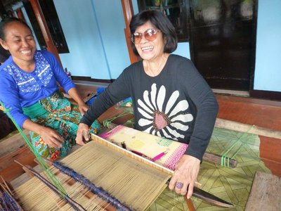 Learning to weave at Dyhaqrmasetya Tenun Village
