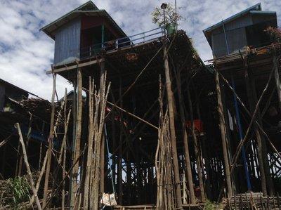 Living in high stilt house in Kampong Phluk village.