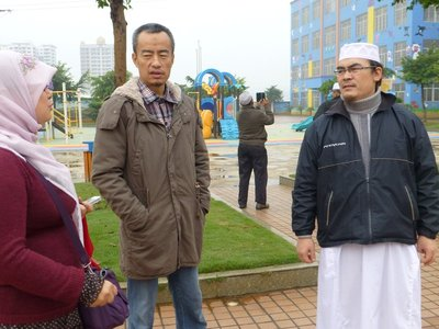 Mr. Yusof Mu, owner and founder of Nuler Kindergarten with Imam Omar Nasir, the Imam for the Shadian Big Mosque.