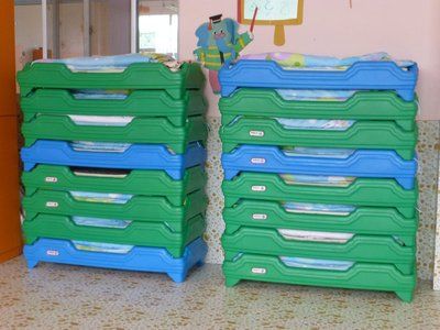 The neatly arranged bedding for the Kindergarten children at Nuler kindergarten in Shadian