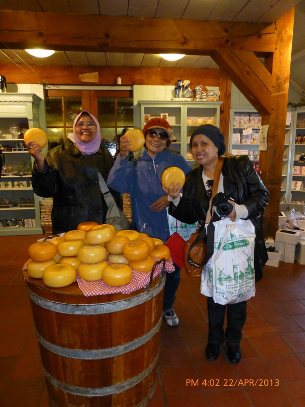 Norlia, me and Akmar holding hard cheese in our hands at Zaanse Schans cheese-making shop. 2204413
