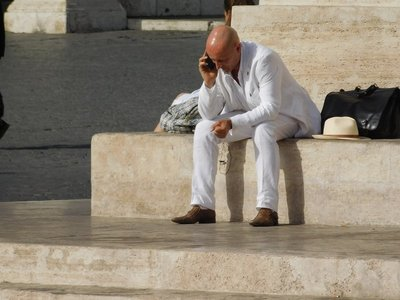 Interesting man in white suit talking on cell phone - Piazza del Popolo - Rome - July 2016