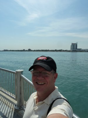 Larry in Detroit Michigan with Windsor Canada in the background (2)