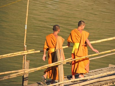 Monks on the bridge crossing the Nam Ou River