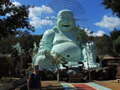 Tam trying to be as happy as the laughing Buddha