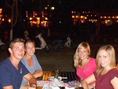 Us and Felix and Sarah at dinner by the river