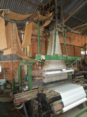 Making silk cloth at the silk factory