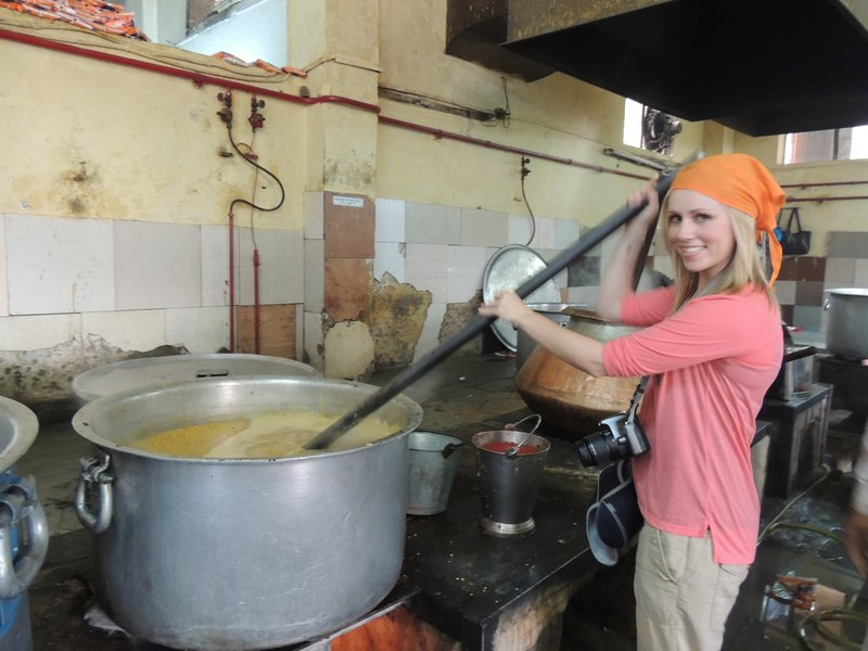 Tam helping out in the kitchen of the Sikh temple