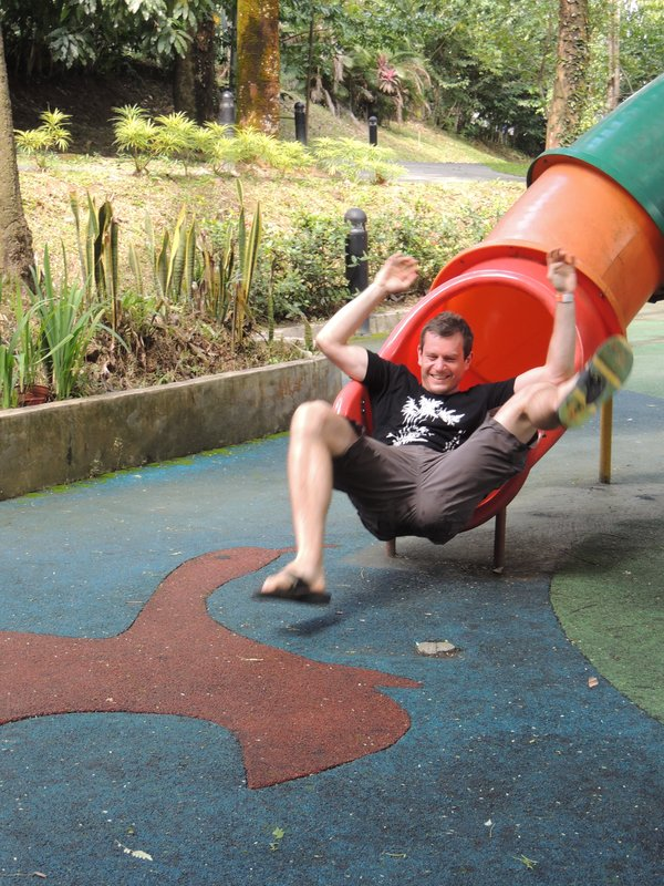 Adam falling out of the children's play slide!
