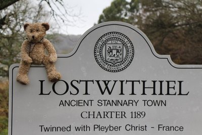 Henry sitting on the Lostwithel sign