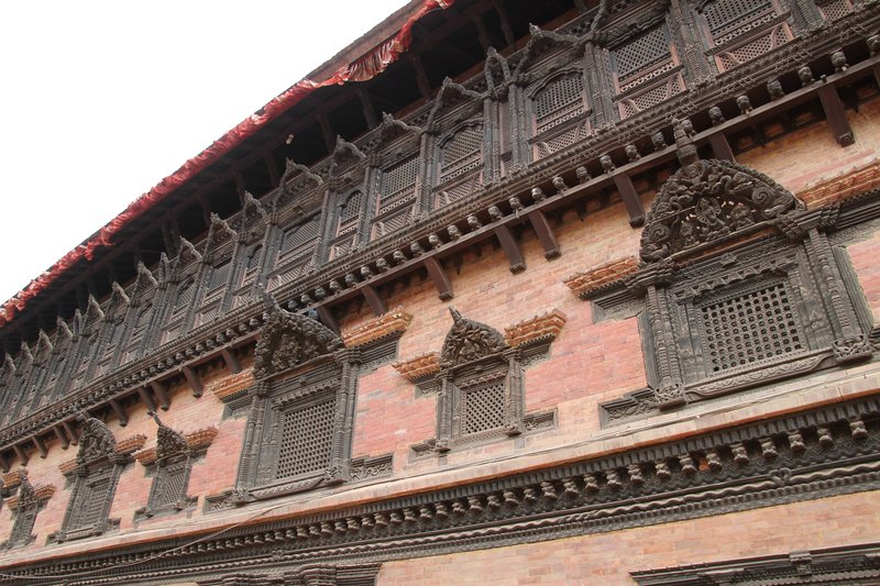 Detailed carving on the windows of buildings in Bhaktapur