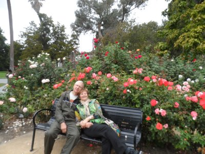 Stopping to smell the roses in the CA state capitol gardens.