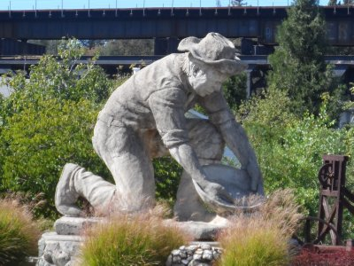 A gold miner statue commemorates the event that brought tons of people to this area.