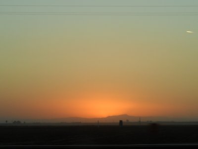 At day's end, we were ever so glad to be traveling on down the flat Central Valley farmland on a straight interstate! And then nature gave us one more gift: a greenish glow to the giant sunset looking west toward the Californai Coastal Range!