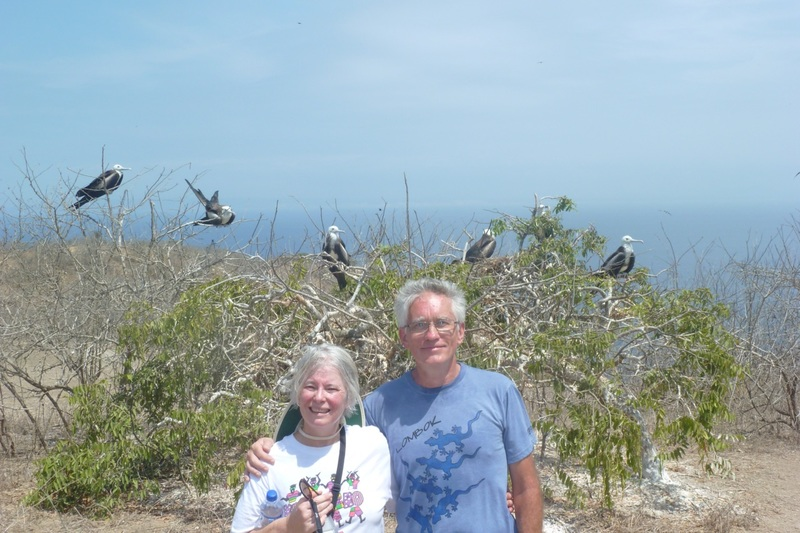 Rhonda & Tom with frigate birds in the backgroun