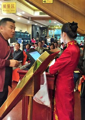 Crowds wait for up to Two Hours for Peking Duck at Historical Restaurant in Beijing